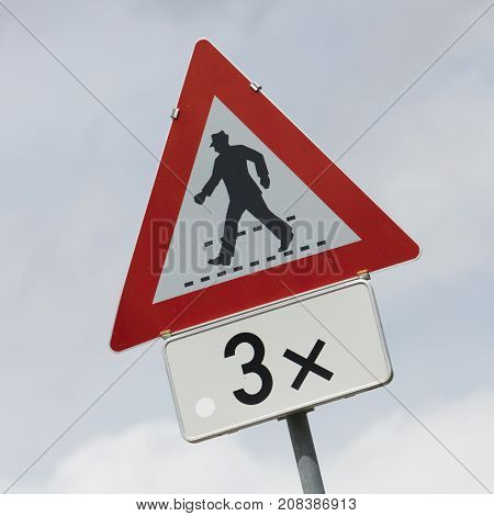 Pedestrians Warning Sign