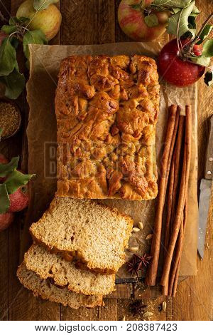 Apple bread rustic style with freshy picked apples and cinnamon, fall baking concept overhead shot