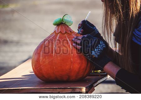 Prepares Jack-o-lantern For Halloween. Decoration For Party.