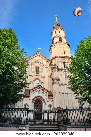 Vilnius, Lithuania - August 13, 2017: Ancient catholic church of all saints in old city center of Vilnius and bright blue sky, Lithuania. Baroque style All Saints church was built in 1620.