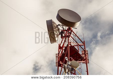 Antenna repeater tower, wireless telecommunication, copy space, vintage toned