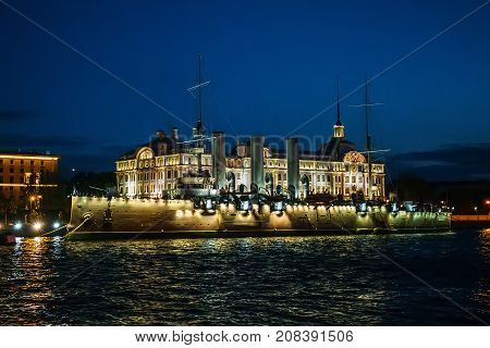 Linear cruiser Aurora or Avrora at night, the symbol of the October revolution in Russia, St. Petersburg