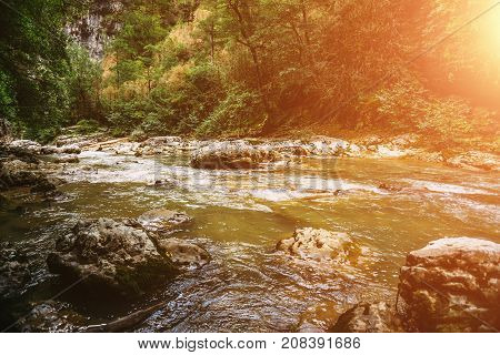 Beautiful view of mountain river in summer at sunset light, Adygeya, Russia