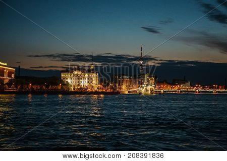Night cityscape, river and Avrora or Aurora in St. Petersburg, Russia