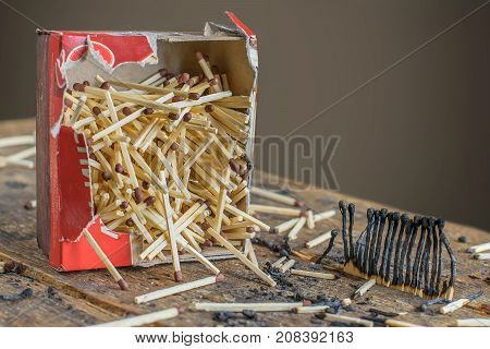 A box of matches and burnt matches.