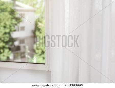 Window sill with beautiful modern curtains in room