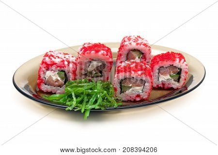 sushi with caviar cucumber and salmon on a plate on a white background. horizontal photo.