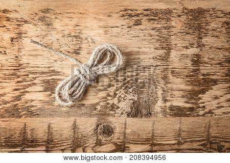 Hemp twine on wooden background