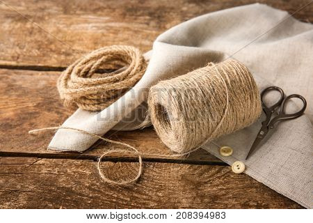 Composition with hemp twine and rope on wooden background
