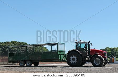 A Tractor and Trailer for Moving People Around a Farm.