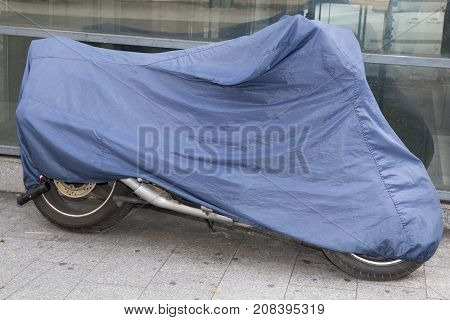 Motorcycle In The Street Protected By A Protective Cover