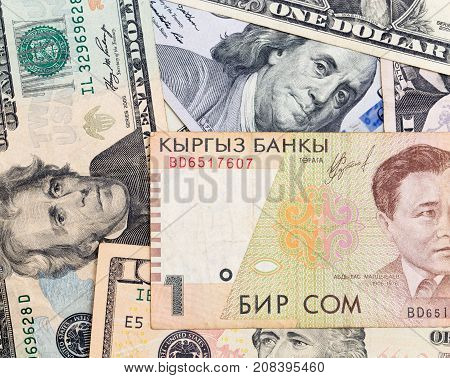 American dollars and Kyrgyz money . Photos in the studio