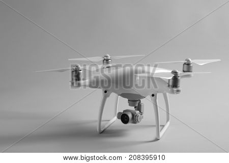 Modern quadcopter on color background