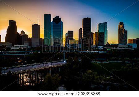 Houston , Texas , USA , Aerial Drone Skyline Cityscape at Sunrise dawn golden hour colors across the sky Sabine Street Bridge and Buffalo River Bayou Park