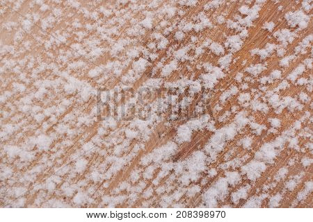 Close-up Diagonal Pattern Of Fiber Of Freshly Sawn Wood Covered With Fluffy Fresh Snow And Copy Spac