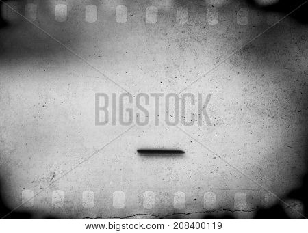 Grunge scratched dirty film strip background with blurred effect