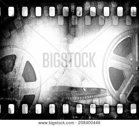Grunge scratched dirty film strip background with reel