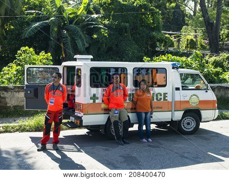 16 Sep 2017 Dumaguete Philippines - ambulance cab with doctors team on street. Resting ambulance team. Doctors and paramedics at work. Philippines doctors. Street life scene with ambulance car