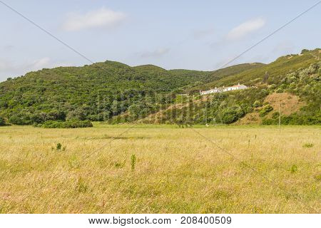 House Over Mountain And Vegetation In Carrapateira