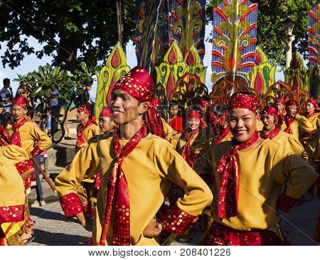 16 Sep 2017 Dumaguete Philippines - smiling children participating in street costume parade. Sandurot festival street dance. Boy in national costume. Philippines festival tradition. Autumn festival