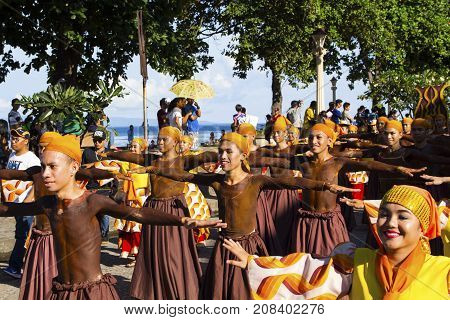 16 Sep 2017 Dumaguete Philippines - smiling children participating in street costume parade. Native costumes of Philippines islands. Sandurot festival. Philippines festival tradition. Street dance