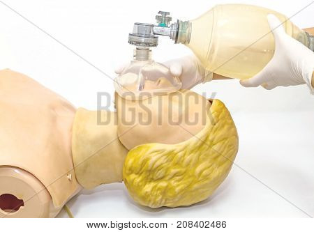 Hand and white medical gloves of doctor demonstration resuscitation CPR Technique by mask with bag on model