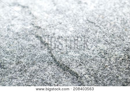 Granitestone textured background with the light bright of the sun. Granite stone is igneous from the magma in the earth.