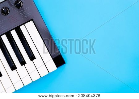 Music keyboard synthesizer instrument on blue copy space for Music poster concept