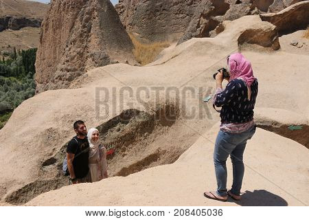21ST JULY 2017, CAPPADOCIA, TURKEY: Tourists visiting the Selime Monastery in Cappadocia, which is one of the largest religious buildings in Cappadocia. turkey, 21st july 2017