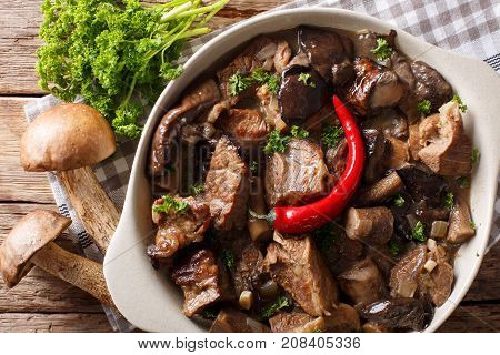 Stew Beef With Wild Forest Mushrooms And Chili Close-up. Horizontal Top View
