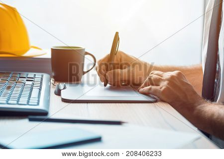Architect construction engineer working with sketch pen tablet in office making a construction project in CAD software selective focus
