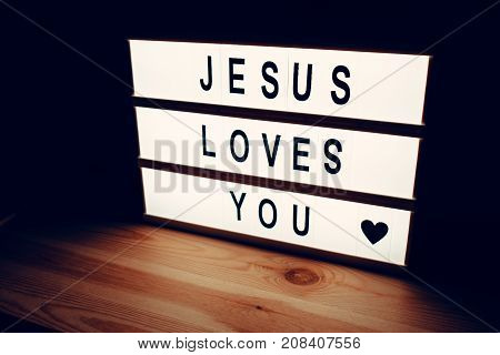 Jesus loves you religious message lightbox concept of christianity and faith in God