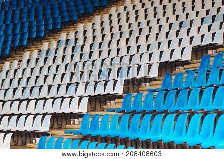 Blue and white plastic stadium seats as repeating pattern