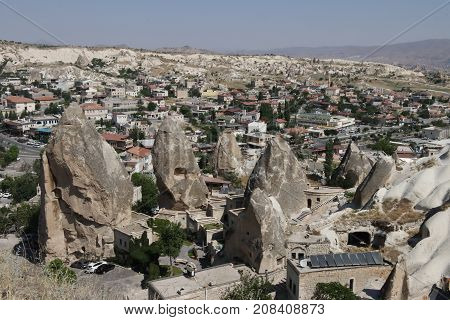 Looking down onto fairy chimneys ,typical geologic formations of Cappadocia, goreme ,excavated by people to be used as houses and churches