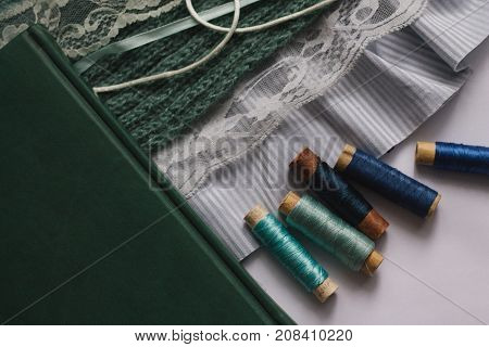 sewing thread, lace ribbon, lace, knitted scarf. preparation for cutting and sewing