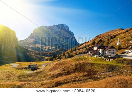 Amazing view on Sassolungo - Langkofel - mountain and Gardena Pass ander autumn sun. Dolomite Alps South Tyrol Italy.