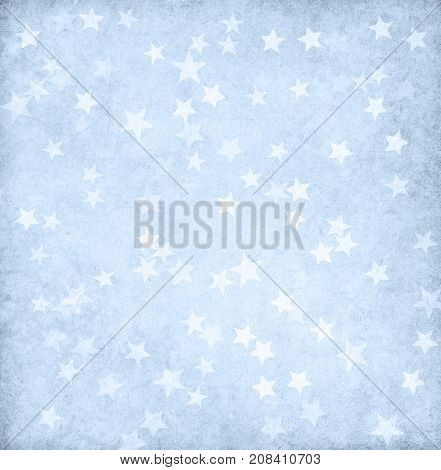 Vintage light blue paper decorated with stars.