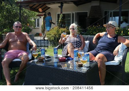 28TH JULY 2017, TURKEY: Three english tourists enjoying a drink while on vacation, 28th july 2017