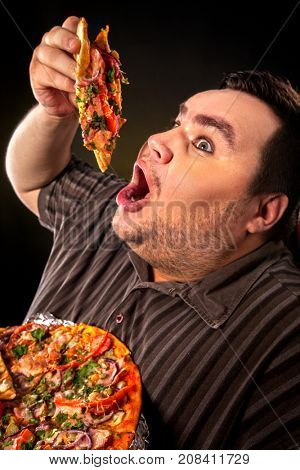 Diet failure of fat man eating fast food slice pizza on plate. Close up of breakfast for hungry overweight person who spoiled healthy food. Use of semi-finished products for food.