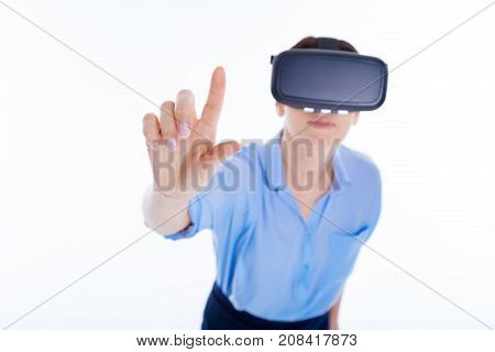 Sensory panel. Selective focus of a female finger touching the sensory screen while being in the virtual reality