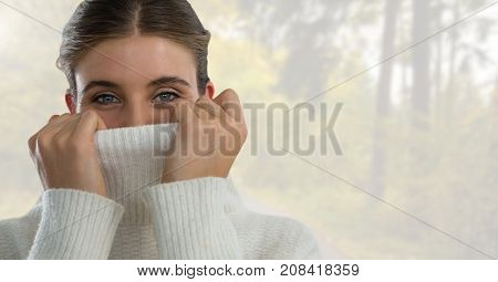 Digital composite of Woman in Autumn with jumper tight in bright forest