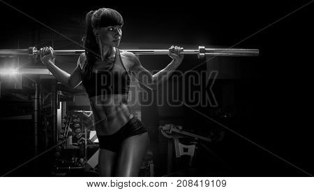 Black And White Photo Of Fit Young Woman In Great Shape Lifting Barbells Looking Focused, Working Ou