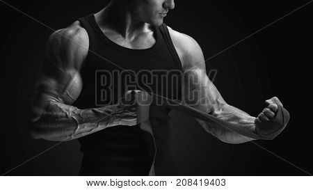 Close Up Photo Of Strong Man Wrap Hands Bodybuilder Man Is Wrapping Hands With Boxing Wraps Isolated