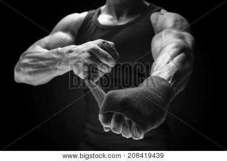 Close-up Photo Of Strong Man Wrap Hands Man Is Wrapping Hands With Boxing Wraps Isolated On Black Ba