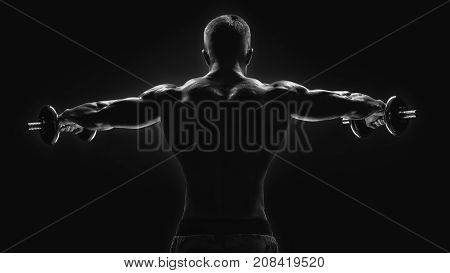Black And White Image Of Dumbbell Lateral Raise Routine Bodybuilder Turning Back Raising Hands Pumpi