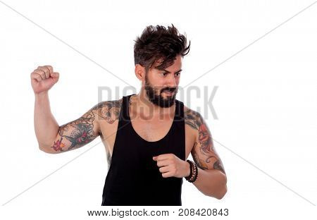 Attractive guy threatening with his fist raised isolated on a white background