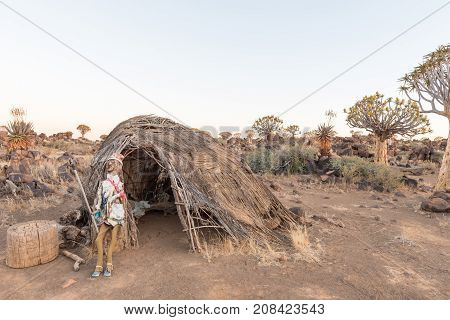 GARAS NAMIBIA - JUNE 14 2017: Sunrise view of a puppet made from sticks in front of a thatch hut at Garas Park Rest Camp near Keetmanshoop on the B1-road to Mariental