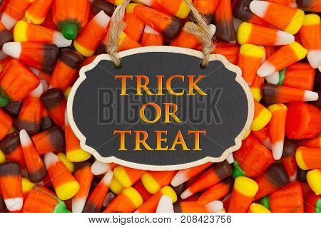 Trick or Treat Greeting with candy corn on a hanging retro chalkboard