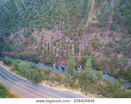 Aerial View Of Mountain Landscape With Forested Hills