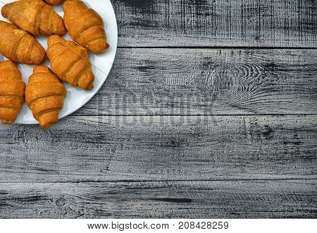 Homemade croissant . Delicious fresh croissant on wood table.